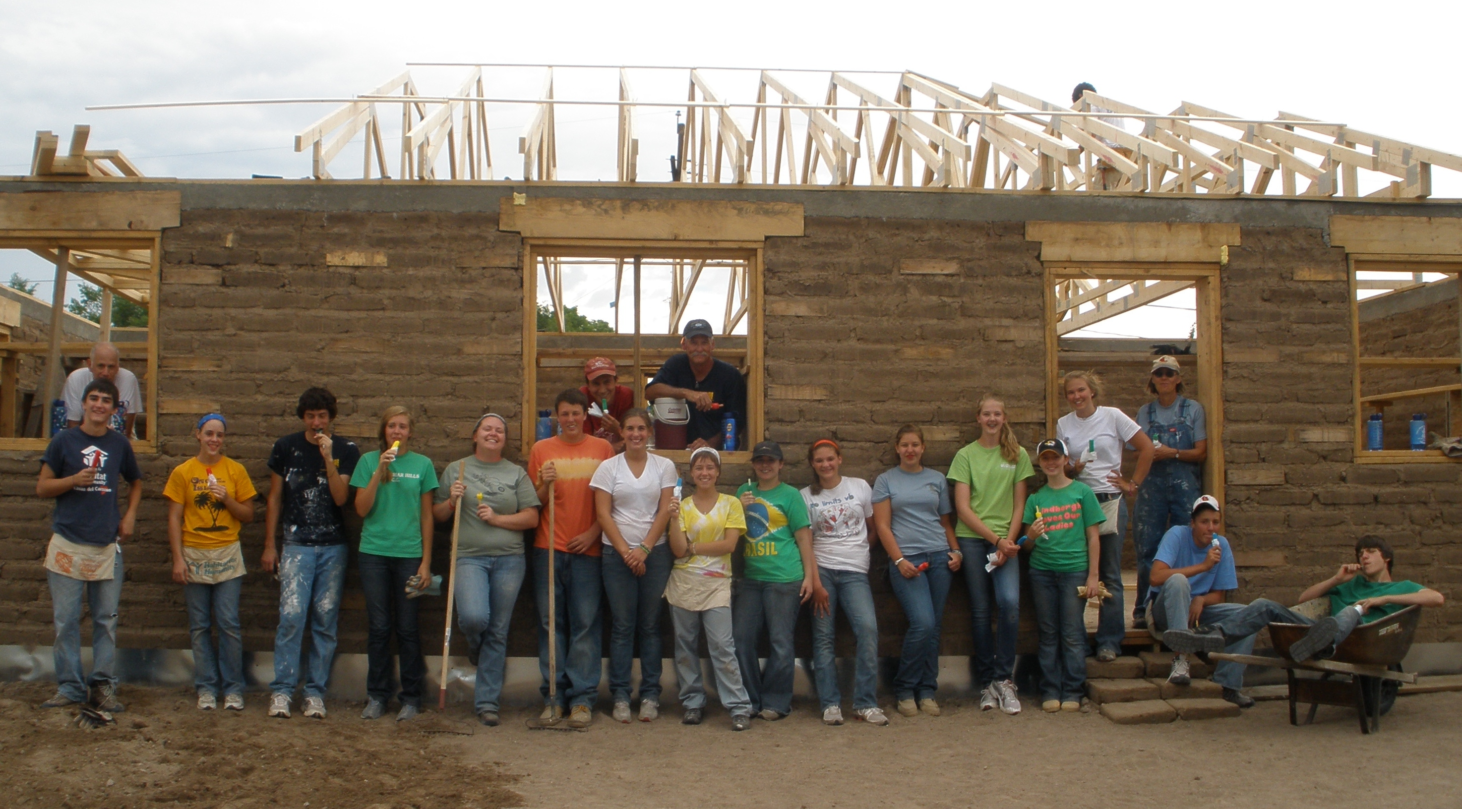 Young adults with their tools ready to help build a Habitat house